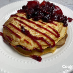 Delicious pancakes topped with berries