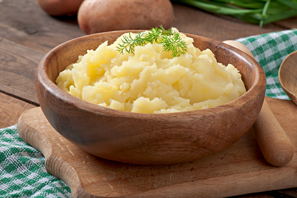 mashed potatoes in a wooden bowl
